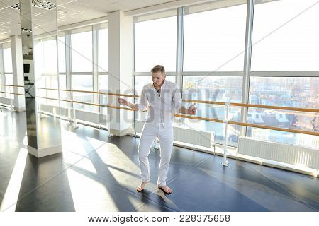 Male Barefoot Dancer Jumping Into Somersault . Young Person Training At Studio With Large Mirrors. C