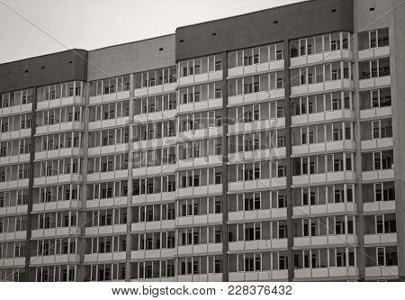 Apartment buildings. Contemporary architecture. Multistorey building. Apartment block. Monochrome.