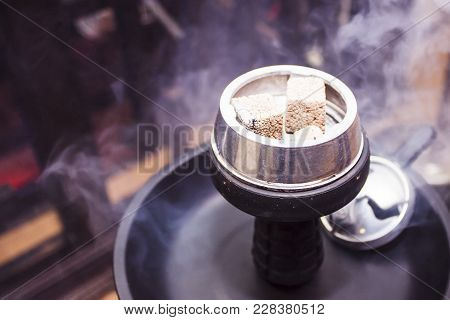 Hookah With Burning Coals Is On The Table.