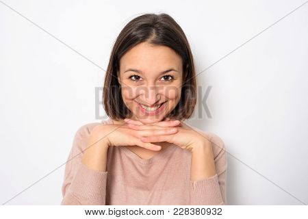Smiling Woman Face Portrait Looking At The Camera Isolated On Background