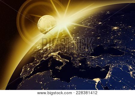 Vision Of The Golden Bitcoin Emerging From Space Against The Background Of The Night Globe