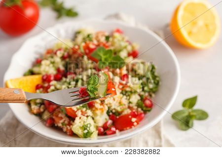 Tabbouleh Salad With Tomato, Cucumber, Couscous, Mint And Pomegranate.  Traditional Middle Eastern O