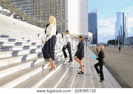 Confident Biz Members With Boss Going Up Stairs In La Defense Paris,  . Concept Of Official Journey