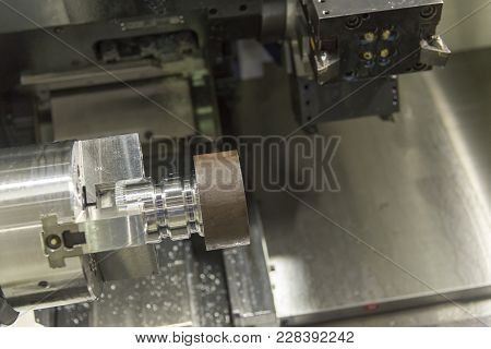 Close Up Of The Cnc Lathe  Clamping  Raw Material Steel Rod . High-precision Cnc Machining Concept.