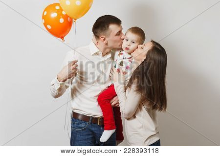 Joyful Young Man, Woman Holding, Kissing, Hugging Little Cute Child Boy, Air Balloons Isolated On Wh