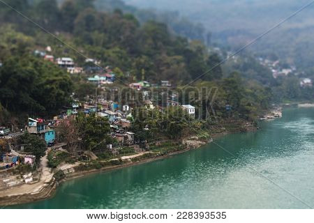 The Small Village Which Located On Picturesque Slopes Of The Mountain At The River Bank With Turquoi