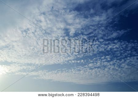 Dramatic Sunset Cloudy Sky With Clouds Lit By Sunlight - Natural Sky Background. Sunset Sky Backgrou