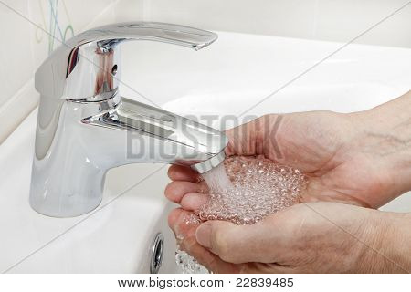 hands under running tap water