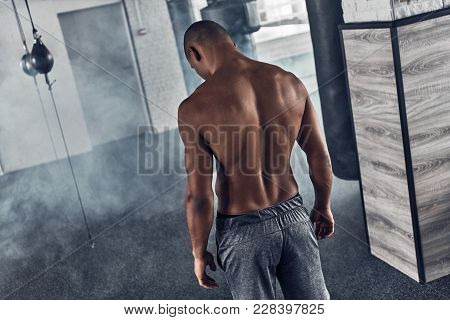 He Is A New Champion. Rear Top View Of Shirtless Young African Man Resting While Standing In The Gym