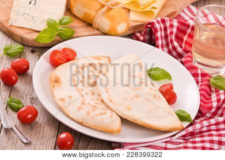 Cascione Italian Flatbread With Cheeses On Wooden Table.