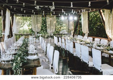 Decorated Elegant Wooden Wedding Table For Banquet Outdoor In Garden, In The Style Of Rustic With Eu