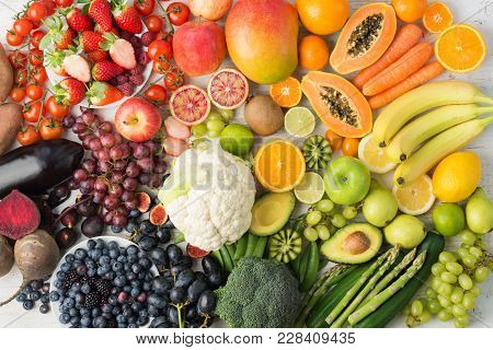 Healthy Eating Background, Assortment Of Different Fruits And Vegetables In Rainbow Colours On The O