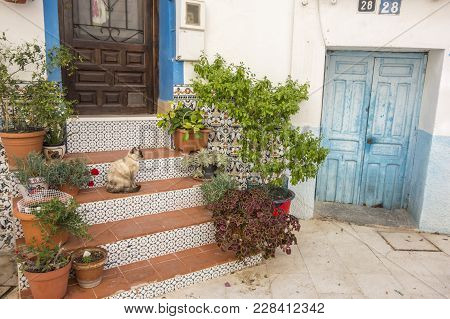 Alicante, Spain- January 18, 2018: Colored Picturesque Houses, Street.typical Neighborhood Historic