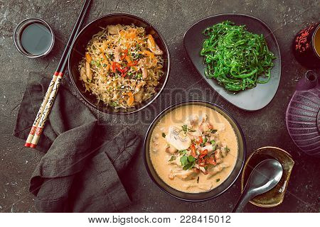 Asian Food, Dishes Of Thai Cuisine. Tom Kha Gai Soup, Pad Thai Noodles, Green Salad, Sauces And Gree