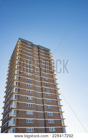 High Rise Block Of Flats On A Clear Blue Sky Background