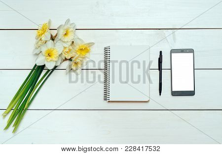 Yellow Bouquet Of Narcissus On White Wooden Background. Blank Card Flat Lay. Top View On Table With