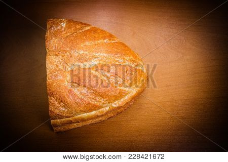 Freshly Baked Wheat Bread On Wooden Table. Top View.