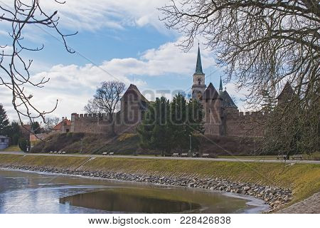 Silhouette Of Town Fortification And Church Of St. Giles In Nymburk, Czech Republic In Winter Day. V