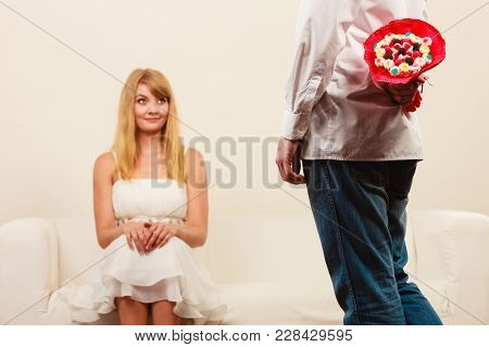 Man Holding Candy Bunch Flowers. Boyfriend With Surprise Present Gift For Pretty Woman Girlfriend. H