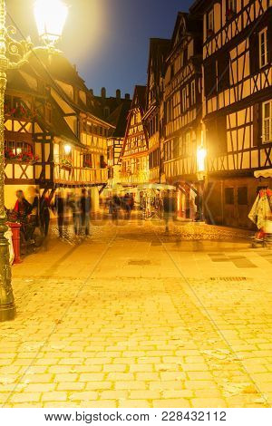 Street Of Petit France Medieval District Of Strasbourg Illuminated At Night, Alsace France