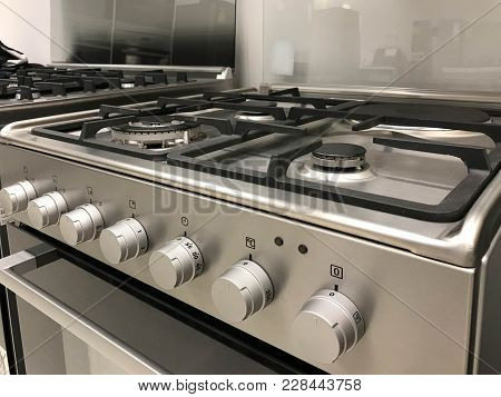 Side View Of Gas Modern Stove And Electric Oven With Oven Regulator, Interior Design