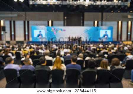 Abstract Blurred Photo Of Conference Hall Or Seminar Room With Attende Background, Business And Educ