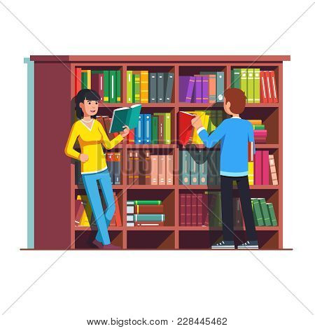 Two People Standing In Front Of Big Wooden Bookcase. Woman Reading Book. Man Picking And Taking Out