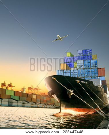 Ship And Container Box And Cargo Plane Flying Over Shipping Dock Use For Logistic And International