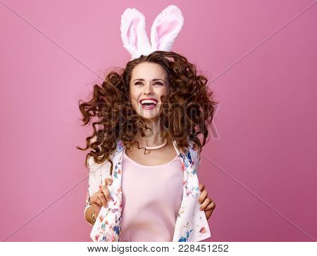 Woman On Pink Background Jumping And Looking At Copy Space