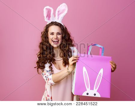 Happy Modern Woman Isolated On Pink Showing Easter Shopping Bag