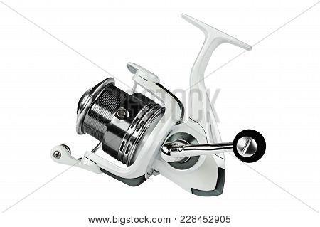 Fishing Reel On Black Background. Feeder Spool For Fishing.