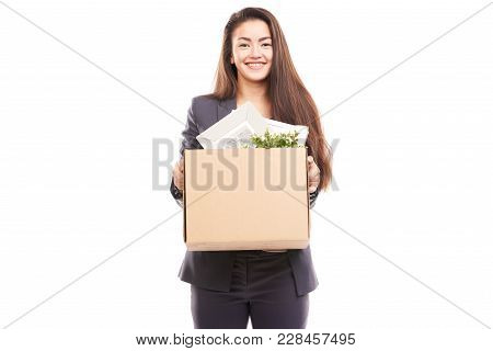 Portrait Of Young Businesswoman Holding Box With Personal Belongings