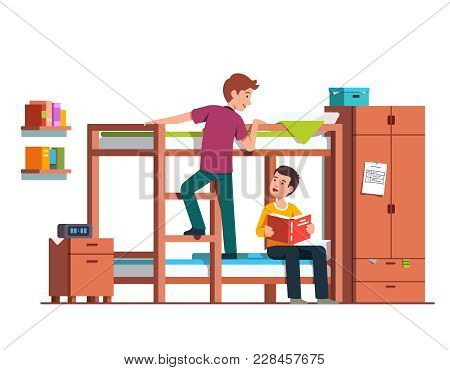 Student Boy Climbing Up Bunk Bed Ladder. Two Teen Brothers Sharing Bedroom. Friends Studying At Home