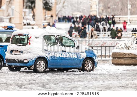 Rome, Italy. February 26, 2018: Police Car Covered By Snow In Rome In Italy. Extraordinary Wave Of B
