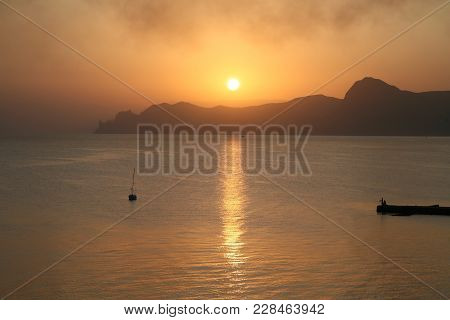 Sunset In The Sea Bay With Foggy Haze