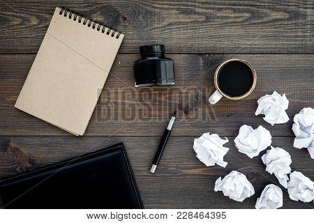 Writer Profession. Retro Concept. Notebook, Pen, Inkpot, Coffee Near Crumpled Paper Balls On Dark Wo