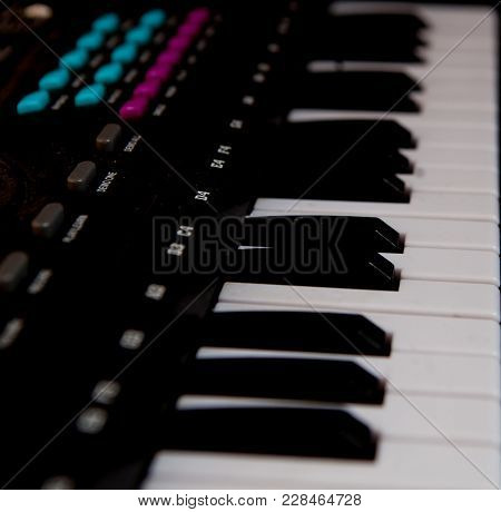 Closeup Black Piano Keys, Black Piano Isolated, Side View Of An Instrument. Learning To Play At Home