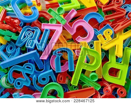 Full Frame Colorful Background Of Plastic Numbers With English And Thai Alphabets