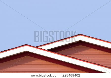 Detail of the rooftops of the typical wooden houses of Iles de la Madeleine, or the Magdalen Islands, in Canada. Minimalistic style in primary colours with space for text.