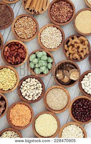Macrobiotic health food with dried pulses, vegetables, cereals, whole wheat pasta, seeds and nuts with foods high in protein, omega 3, anthocyanins, antioxidants, minerals and vitamins.