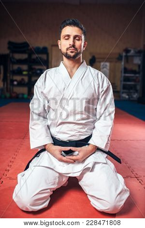 Martial arts, man in white kimono with black belt