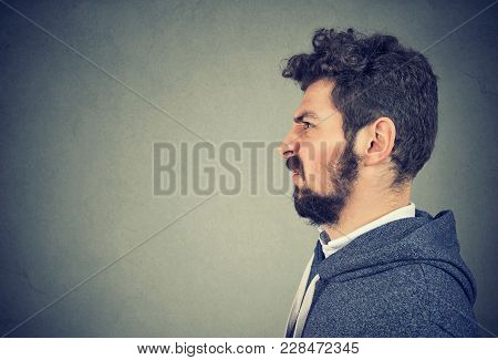 Side View Of Casual Hipster Bearded Man With Expression Of Disgust On Face Looking Away.