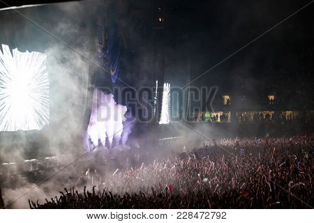 Cluj-Napoca, Romania - August 6, 2017:  Crowd of people having fun at Untold Festival, the largest annual electronic music festival held in Romania.