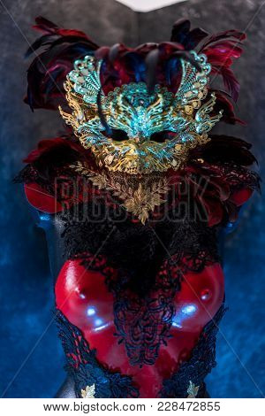 Masquerade Party Venetian red, mask and red corset with pieces of gold and black lace fabrics on metal breastplate. handmade piea for parties or costume meetings