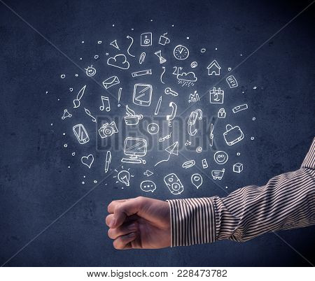 Mixed white media and communication related icons hovering above young hand