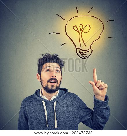 Casual Bearded Man In Hoodie Pointing Up Enlightenment With Great Idea.