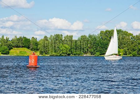Yacht And Buoy On The Lake On Summer Day