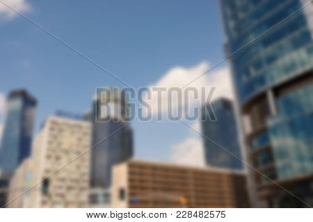 Defocused Image Of Modern Office Buildings And Skyscrapers In The Commercial District Of A City On A