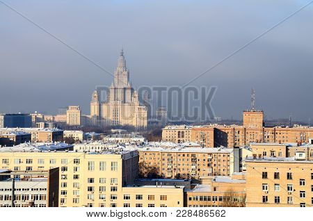 View Of The Main Building Of Lomonosov Moscow State University, Surrounded By The Residential Houses