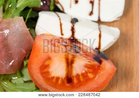 Starter Platter With Tomatoes And Mozzarella. Macro. Photo Can Be Used As A Whole Background.